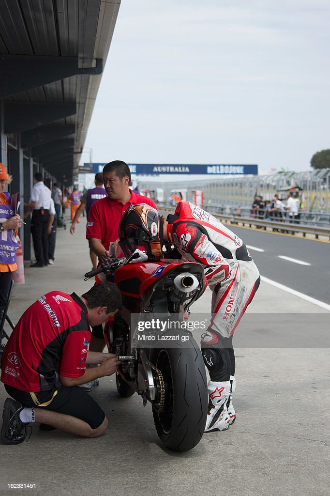 Josh Hook of Australia and Team Honda Racing looks on the bike during qualifying practice of Supersport ahead of the World Superbikes at Phillip Island Grand Prix Circuit on February 22, 2013 in Phillip Island, Australia.