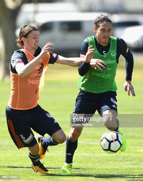 Josh Hope and Mark Milligan of the Victory compete for the ball during a Melbourne Victory ALeague training session at Gosch's Paddock on October 17...