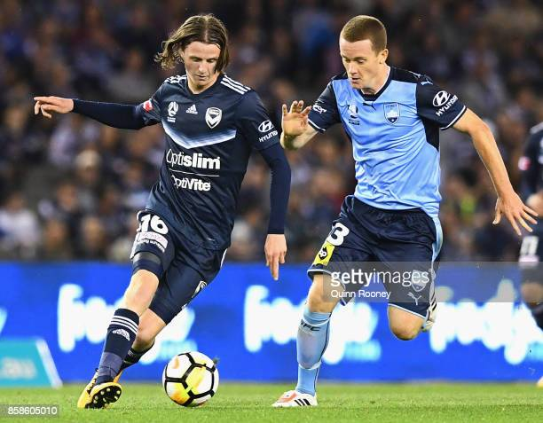 Josh Hope of the Victory and Brandon O'Neill of Sydney FC compete for the ball during the round one ALeague match between the Melbourne Victory and...