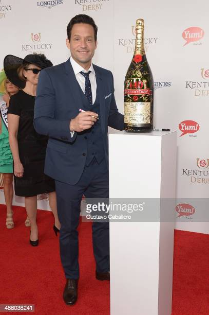 Josh Hopkins toasts with Moet Chandon at the 140th Kentucky Derby at Churchill Downs on May 3 2014 in Louisville Kentucky