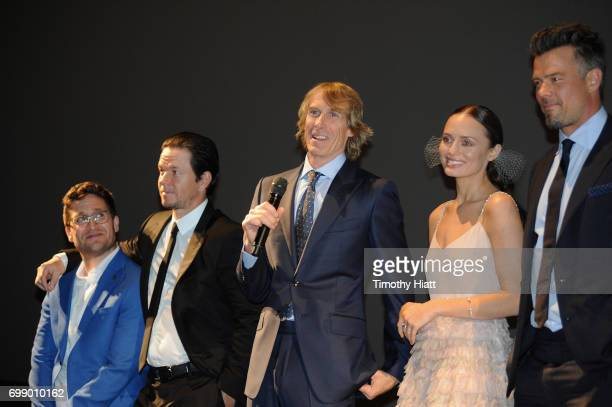 Josh Horowitz Mark Wahlberg Michael Bay Laura Haddock and Josh Duhamel speak onstage at the US premiere of 'Transformers The Last Knight' at the...