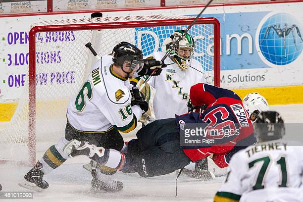 Josh HoSang of the Windsor Spitfires fires a shot on Jake Patterson of the London Knights after a huge hit from Max Domi in Game 4 of their OHL...