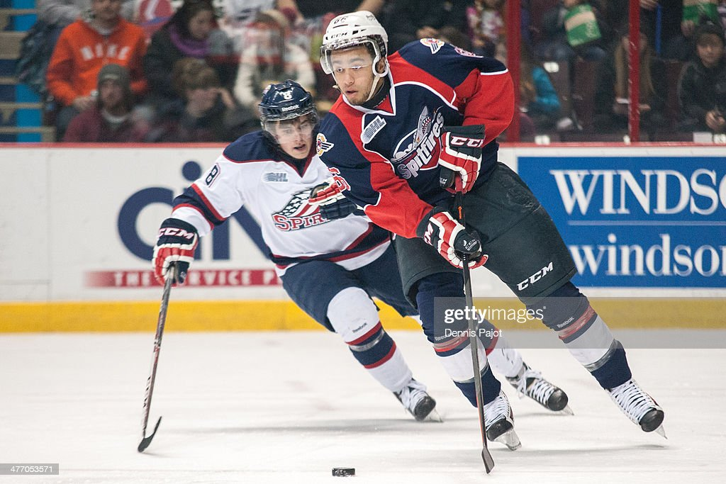 Josh Ho-Sang #66 of the Windsor Spitfires skates against Andrew Alexeev #8 of the Saginaw Spirit on March 6, 2014 at the WFCU Centre in Windsor, Ontario, Canada.