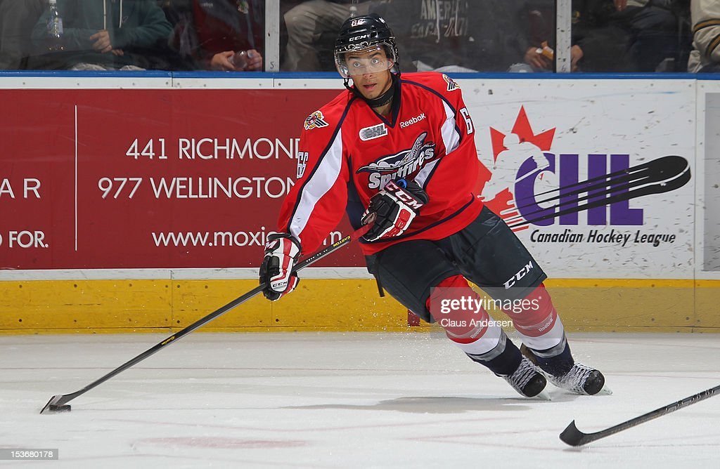 Josh Ho-Sang #66 of the Windsor Spitfires skates with the puck in an OHL game against the London Knights on October 5, 2012 at the Budweiser Gardens in London, Canada. The Knights defeated the Spitfires 8-2.