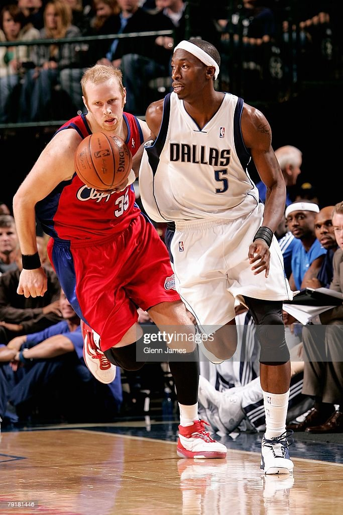 Josh Howard #5 of the Dallas Mavericks brings the ball upcourt followed by Chris Kaman #35 of the Los Angeles Clippers during the game on December 21, 2007 at American Airlines Center in Dallas, Texas. The Mavericks won 102-89.