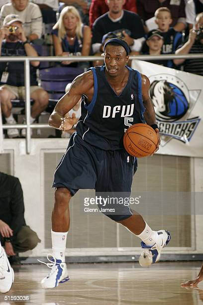 Josh Howard of the Dallas Mavericks dribbles upcourt during an intrasquad exhibition at the Mavs Fan Jam on October 9 2004 at Texas Christian...