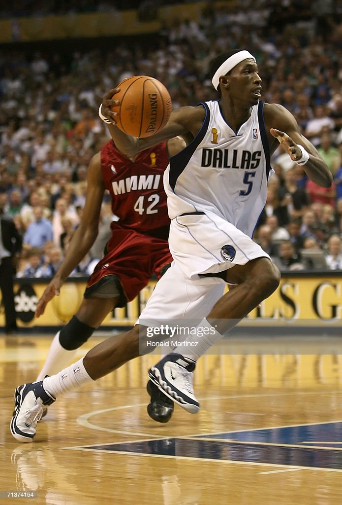 Josh Howard #5 of the Dallas Mavericks moves past James Posey #42 of the Miami Heat in game six of the 2006 NBA Finals on June 20, 2006 at American Airlines Center in Dallas, Texas. The Heat won 95-92 and win the series 4-2.