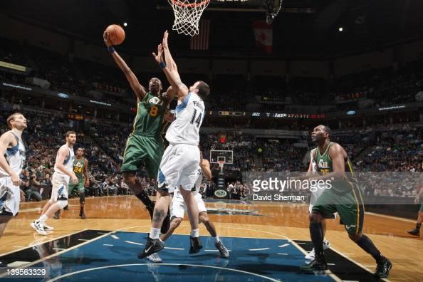 Josh Howard of the Utah Jazz goes to the basket against Nikola Pekovic of the Minnesota Timberwolves during the game between the Minnesota...
