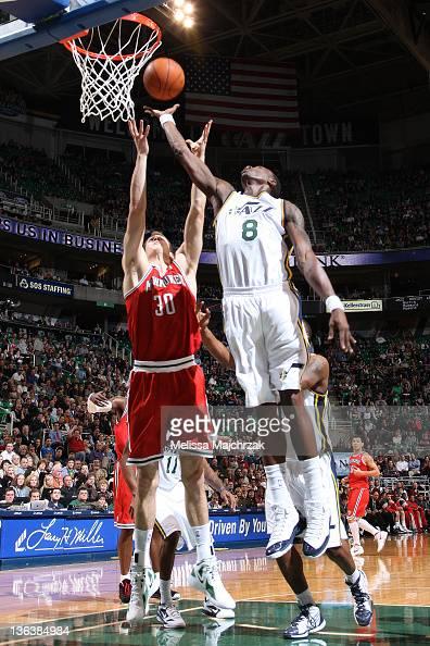 Josh Howard of the Utah Jazz goes up for a rebound against Jon Leuer of the Milwaukee Bucks at Energy Solutions Arena on January 03 2012 in Salt Lake...