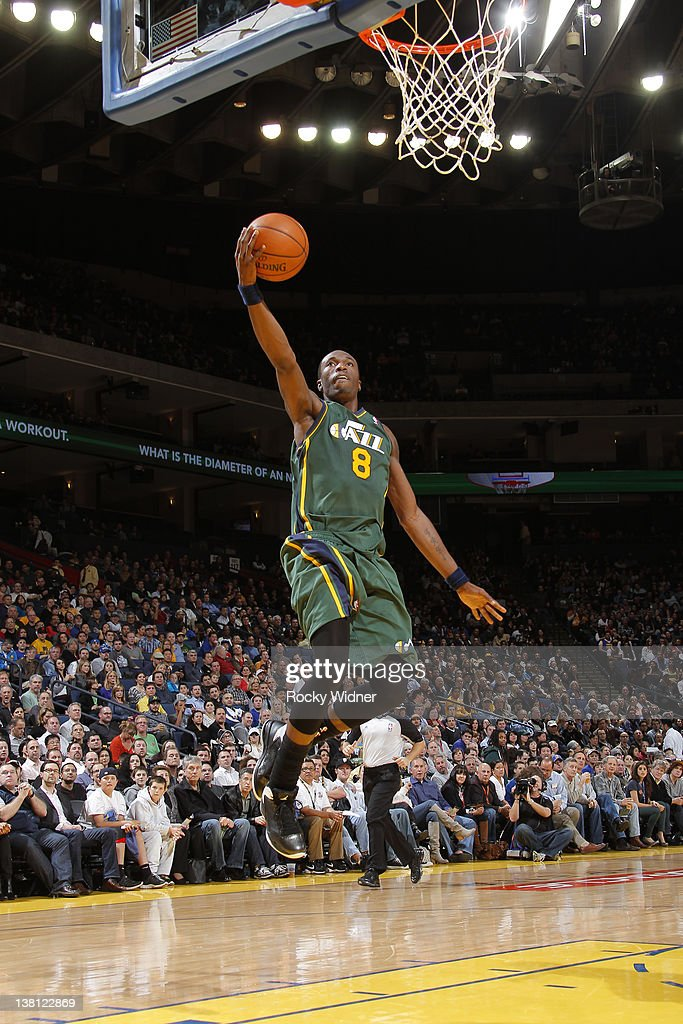 <a gi-track='captionPersonalityLinkClicked' href=/galleries/search?phrase=Josh+Howard&family=editorial&specificpeople=201718 ng-click='$event.stopPropagation()'>Josh Howard</a> #8 of the Utah Jazz lays the ball up on a fast break against the Golden State Warriors on February 2, 2012 at Oracle Arena in Oakland, California.