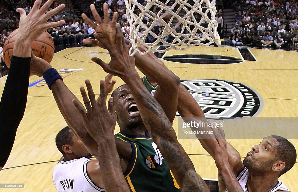 Josh Howard #8 of the Utah Jazz takes a shot against Tim Duncan #21 and the defense of the San Antonio Spurs in Game Two of the Western Conference Quarterfinals of the 2012 NBA Playoffs at AT&T Center on May 2, 2012 in San Antonio, Texas.