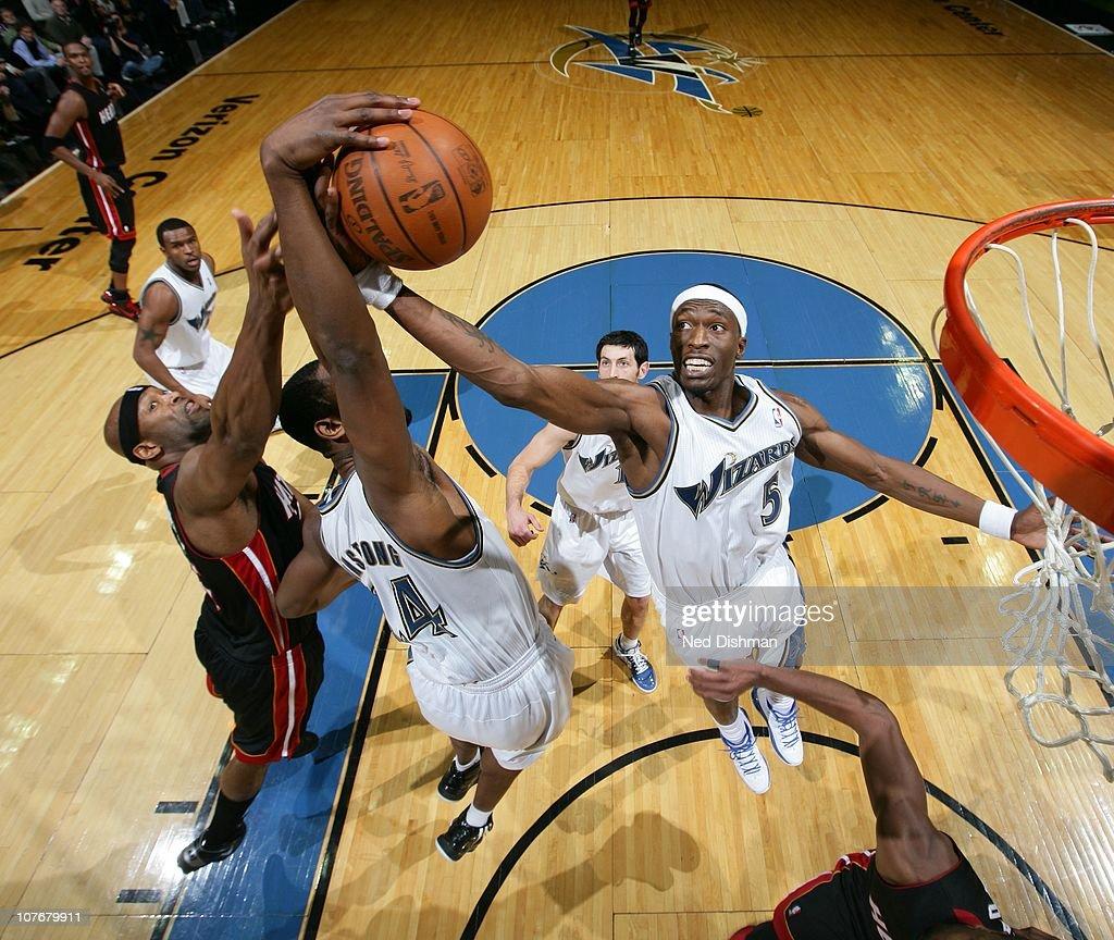Josh Howard #5 of the Washington Wizards rebounds against Erick Dampier #25 of the Miami Heat at the Verizon Center on December 18, 2010 in Washington, DC.