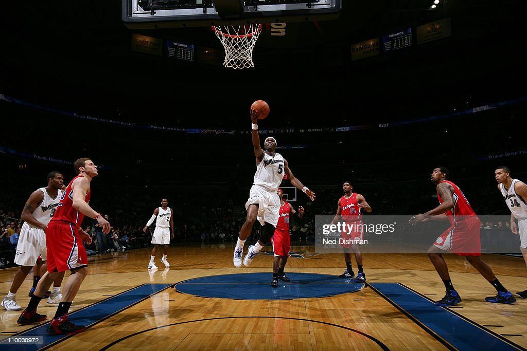 <a gi-track='captionPersonalityLinkClicked' href=/galleries/search?phrase=Josh+Howard&family=editorial&specificpeople=201718 ng-click='$event.stopPropagation()'>Josh Howard</a> #5 of the Washington Wizards shoots against the Los Angeles Clippers at the Verizon Center on March 12, 2011 in Washington, DC.