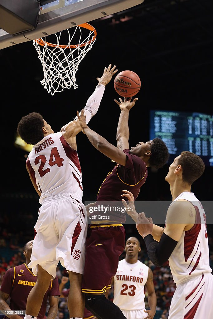 Josh Huestis #24 of the Stanford Cardinal blocks a shot from Carrick Felix #0 of the Arizona State Sun Devils in the first half during the first round of the Pac 12 Tournament at the MGM Grand Garden Arena on March 13, 2013 in Las Vegas, Nevada.