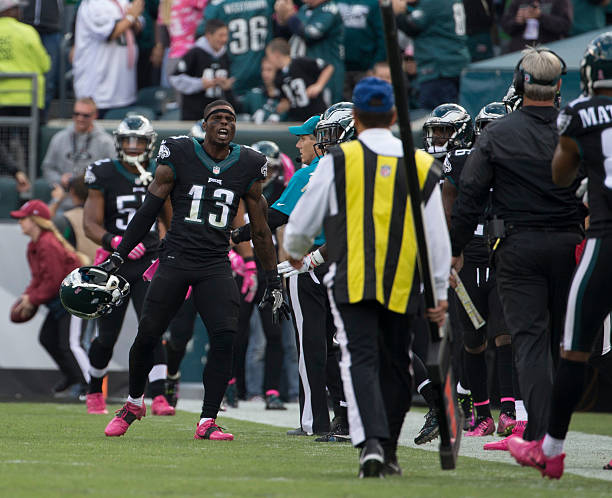 a1755f4fdfc ... Josh Huff 13 of the Philadelphia Eagles reacts after returning a  kickoff for a touchdown ...