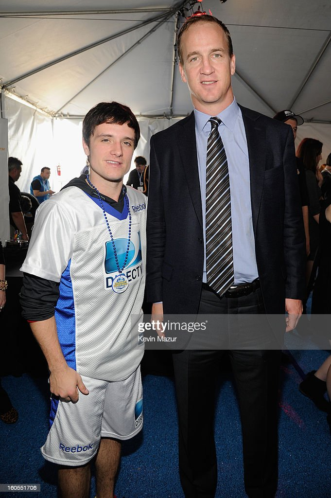 Josh Hutcherson (L) and Peyton Manning attend DIRECTV'S 7th annual celebrity Beach Bowl at DTV SuperFan Stadium at Mardi Gras World on February 2, 2013 in New Orleans, Louisiana.