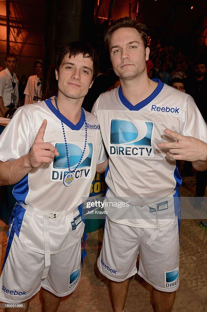 Josh Hutcherson (L) and Scott Porter attend DIRECTV'S 7th Annual Celebrity Beach Bowl at DTV SuperFan Stadium at Mardi Gras World on February 2, 2013 in New Orleans, Louisiana.
