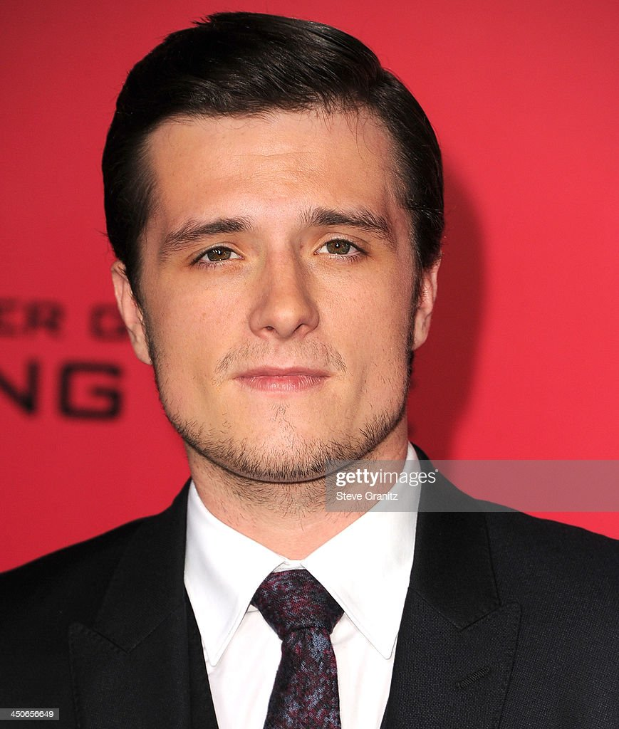 <a gi-track='captionPersonalityLinkClicked' href=/galleries/search?phrase=Josh+Hutcherson&family=editorial&specificpeople=673588 ng-click='$event.stopPropagation()'>Josh Hutcherson</a> arrives at the 'The Hunger Games: Catching Fire' - Los Angeles Premiere at Nokia Theatre L.A. Live on November 18, 2013 in Los Angeles, California.
