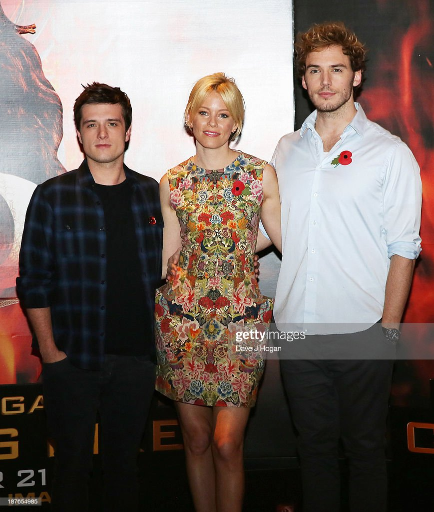 <a gi-track='captionPersonalityLinkClicked' href=/galleries/search?phrase=Josh+Hutcherson&family=editorial&specificpeople=673588 ng-click='$event.stopPropagation()'>Josh Hutcherson</a>, <a gi-track='captionPersonalityLinkClicked' href=/galleries/search?phrase=Elizabeth+Banks&family=editorial&specificpeople=202475 ng-click='$event.stopPropagation()'>Elizabeth Banks</a> and <a gi-track='captionPersonalityLinkClicked' href=/galleries/search?phrase=Sam+Claflin&family=editorial&specificpeople=7238693 ng-click='$event.stopPropagation()'>Sam Claflin</a> attend a photocall for 'The Hunger Games: Catching Fire' at Corinthia Hotel London on November 11, 2013 in London, England.