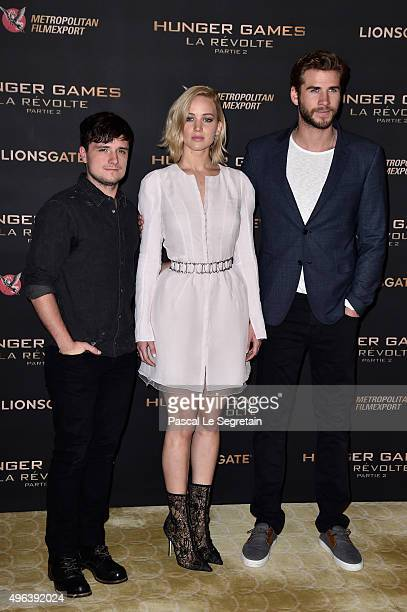 Josh HutchersonJennifer Lawrence and Liam Hemsworth attend the The Hunger Games Mockingjay Part 2 Photocall at Plazza Athenee on November 9 2015 in...