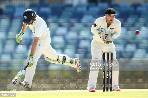 Josh Inglis of Western Australia takes a return throw as Daniel Hughes of New South Wales makes his ground during the Sheffield Shield match between...