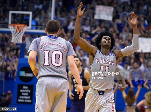 Josh Jackson celebrates a three point shot with Sviatoslav Mykhailiuk of the Kansas Jayhawks during a game against the TCU Horned Frogs in the second...