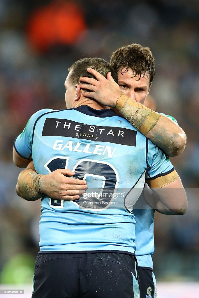 Josh Jackson of the Blues embraces Paul Gallen of the Blues after game three of the State Of Origin series between the New South Wales Blues and the Queensland Maroons at ANZ Stadium on July 13, 2016 in Sydney, Australia.