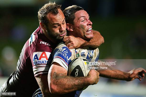Josh Jackson of the Bulldogs is tackled by Brett Stewart of the Sea Eagles during the round 13 NRL match between the ManlyWarringah Sea Eagles and...