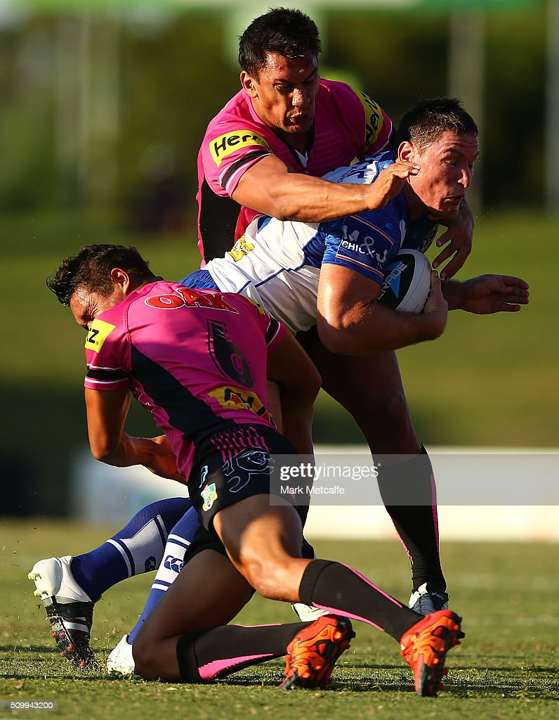 <a gi-track='captionPersonalityLinkClicked' href=/galleries/search?phrase=Josh+Jackson+-+Rugby+League+Player&family=editorial&specificpeople=241393 ng-click='$event.stopPropagation()'>Josh Jackson</a> of the Bulldogs is tackled during the NRL Trial match between the Canterbury Bulldogs and the Penrith Panthers at Pepper Stadium on February 13, 2016 in Sydney, Australia.