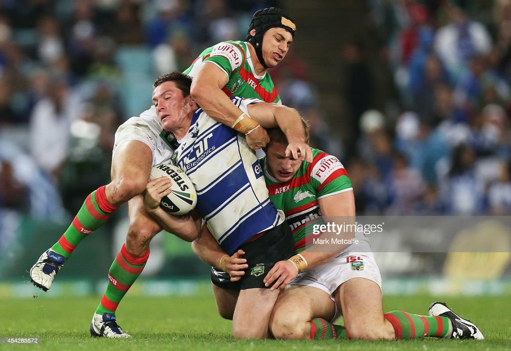 Josh Jackson of the Bulldogs is tackled during the round 25 NRL match between the Canterbury Bulldogs and the South Sydney Rabbitohs at ANZ Stadium on August 28, 2014 in Sydney, Australia.