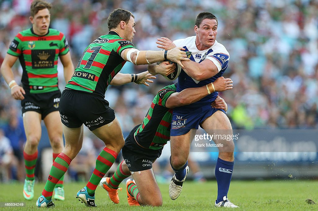 <a gi-track='captionPersonalityLinkClicked' href=/galleries/search?phrase=Josh+Jackson+-+Rugby+League+Player&family=editorial&specificpeople=241393 ng-click='$event.stopPropagation()'>Josh Jackson</a> of the Bulldogs is tackled during the round seven NRL match between the South Sydney Rabbitohs and the Canterbury-Bankstown Bulldogs at ANZ Stadium on April 18, 2014 in Sydney, Australia.