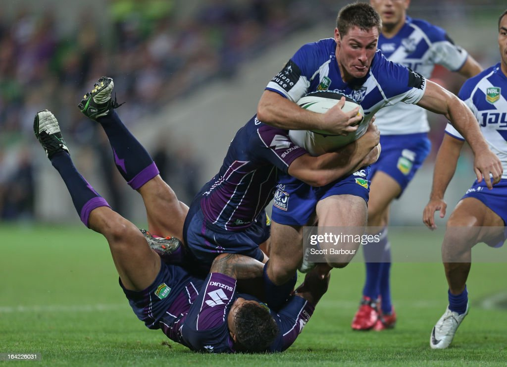 <a gi-track='captionPersonalityLinkClicked' href=/galleries/search?phrase=Josh+Jackson+-+Rugby+League+Player&family=editorial&specificpeople=241393 ng-click='$event.stopPropagation()'>Josh Jackson</a> of the Bulldogs is tackled during the round three NRL match between the Melbourne Storm and the Canterbury Bulldogs at AAMI Park on March 21, 2013 in Melbourne, Australia.