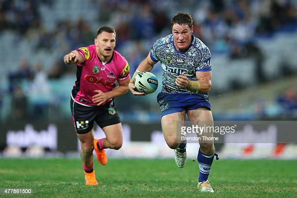 Josh Jackson of the Bulldogs runs the ball during the round 15 NRL match between the Canterbury Bulldogs and the Penrith Panthers at ANZ Stadium on...
