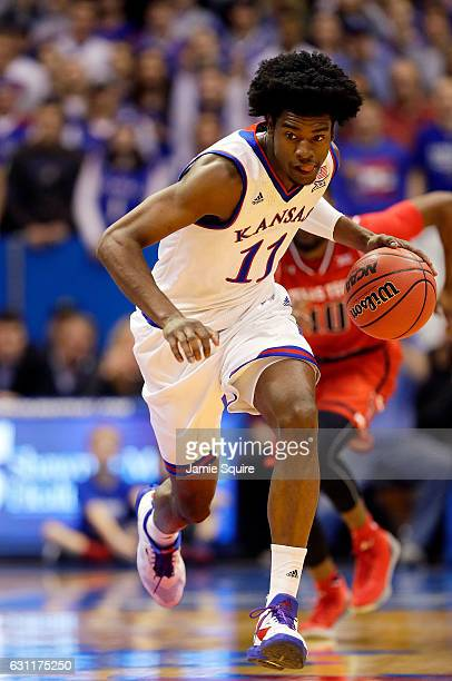 Josh Jackson of the Kansas Jayhawks controls the ball on a fast break during the game against the Texas Tech Red Raiders at Allen Fieldhouse on...