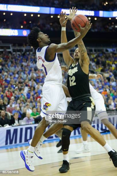 Josh Jackson of the Kansas Jayhawks drives to the basket against Vince Edwards of the Purdue Boilermakers in the first half during the 2017 NCAA...