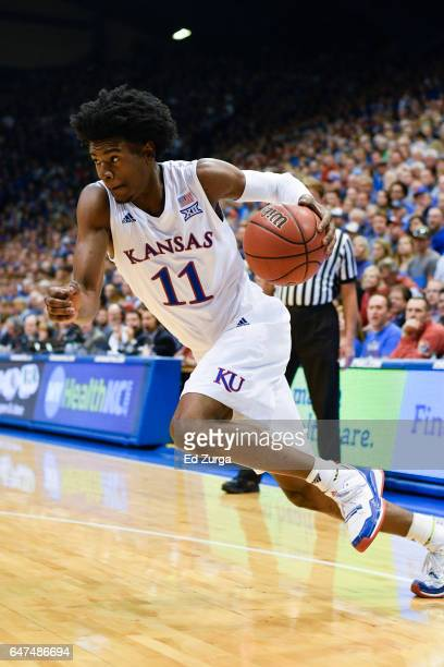 Josh Jackson of the Kansas Jayhawks drives to the basket against the Oklahoma Sooners at Allen Fieldhouse on February 27 2017 in Lawrence Kansas
