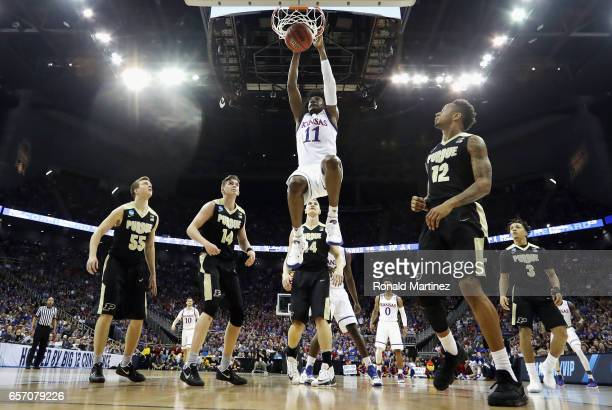 Josh Jackson of the Kansas Jayhawks dunks the ball in the first half against the Purdue Boilermakers during the 2017 NCAA Men's Basketball Tournament...