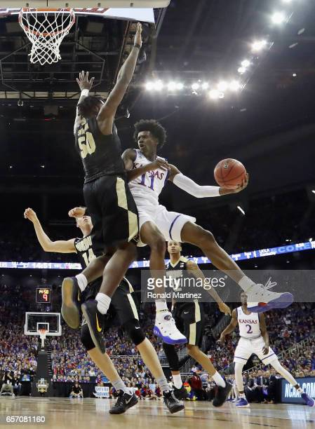 Josh Jackson of the Kansas Jayhawks handles the ball against Caleb Swanigan of the Purdue Boilermakers in the first half during the 2017 NCAA Men's...