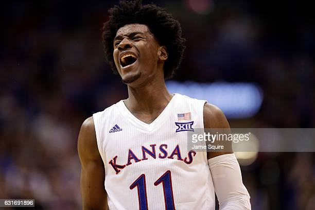 Josh Jackson of the Kansas Jayhawks reacts after a foul during the game against the Oklahoma State Cowboys at Allen Fieldhouse on January 14 2017 in...