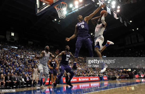 Josh Jackson of the Kansas Jayhawks tries to shoot over Brandon Parrish of the TCU Horned Frogs in the first half at Allen Fieldhouse on February 22...