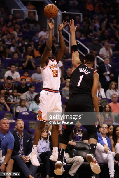 Josh Jackson of the Phoenix Suns puts up a shot over Evan Turner of the Portland Trail Blazers during the first half of the NBA game at Talking Stick...