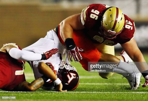 Josh Jackson of the Virginia Tech Hokies is tackled by Harold Landry and Ray Smith of the Boston College Eagles during the second quarter of their...