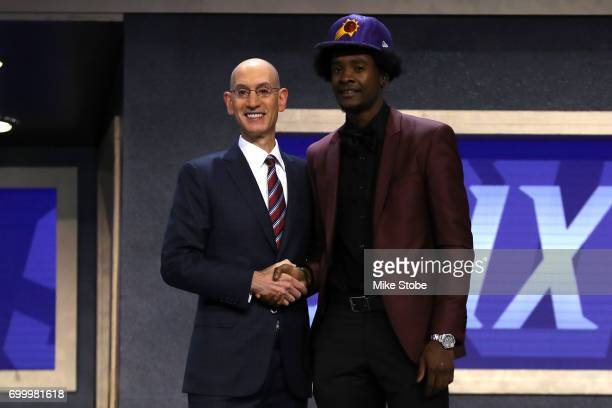 Josh Jackson walks on stage with NBA commissioner Adam Silver after being drafted fourth overall by the Phoenix Suns during the first round of the...