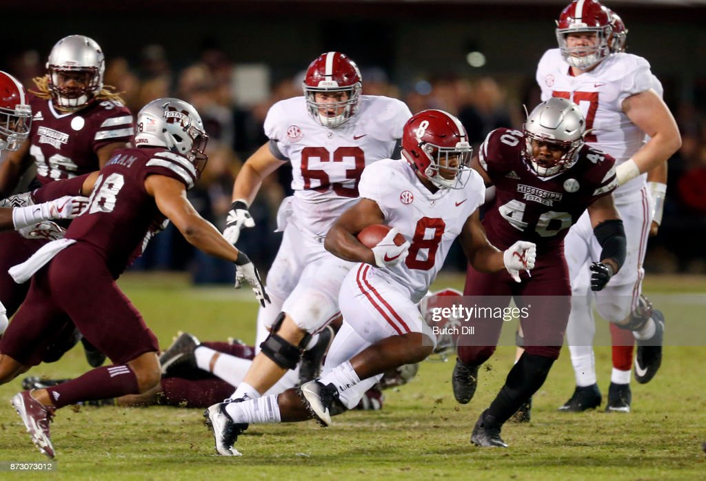 Josh Jacobs #8 of the Alabama Crimson Tide carries the ball for a first down during the second half of an NCAA football game against the Mississippi State Bulldogs at Davis Wade Stadium on November 11, 2017 in Starkville, Mississippi.