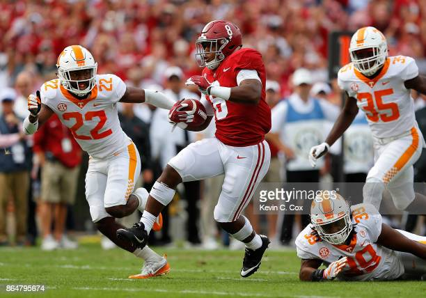 Josh Jacobs of the Alabama Crimson Tide rushes against Kendal Vickers and Micah Abernathy of the Tennessee Volunteers at BryantDenny Stadium on...