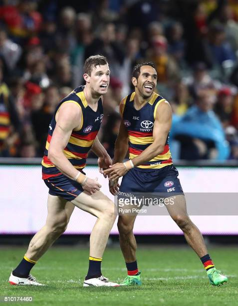 Josh Jenkins and Eddie Betts of the Crows celebrate a goal during the round 16 AFL match between the Adelaide Crows and the Western Bulldogs at...