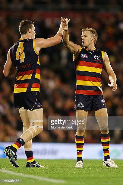 Josh Jenkins and Nathan van Berlo of the Crows celebrate after Jenkins kicked a goal during the round eight AFL match between the Adelaide Crows and...