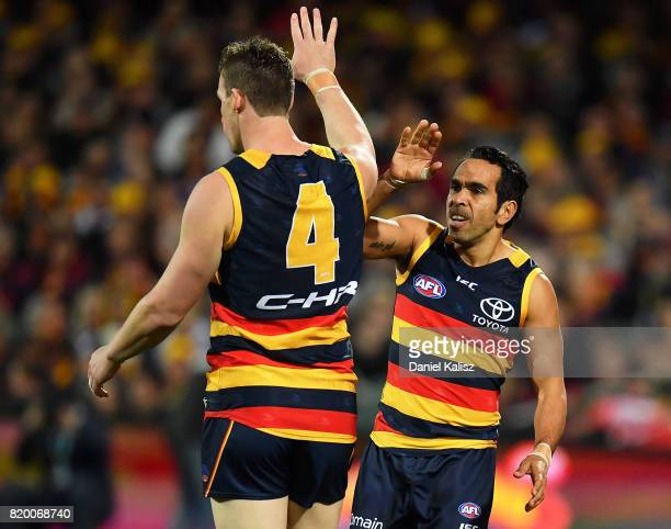 Josh Jenkins is congratulated by Eddie Betts of the Crows after kicking a goal during the round 18 AFL match between the Adelaide Crows and the...