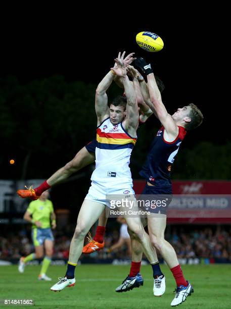 Josh Jenkins of the Crows and Oscar McDonald of the Demons compete for the ball during the round 17 AFL match between the Melbourne Demons and the...