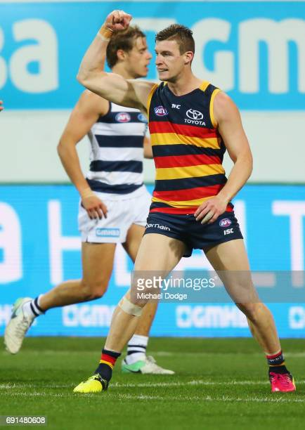Josh Jenkins of the Crows celebrates a goal during the round 11 AFL match between the Geelong Cats and the Adelaide Crows at Simonds Stadium on June...